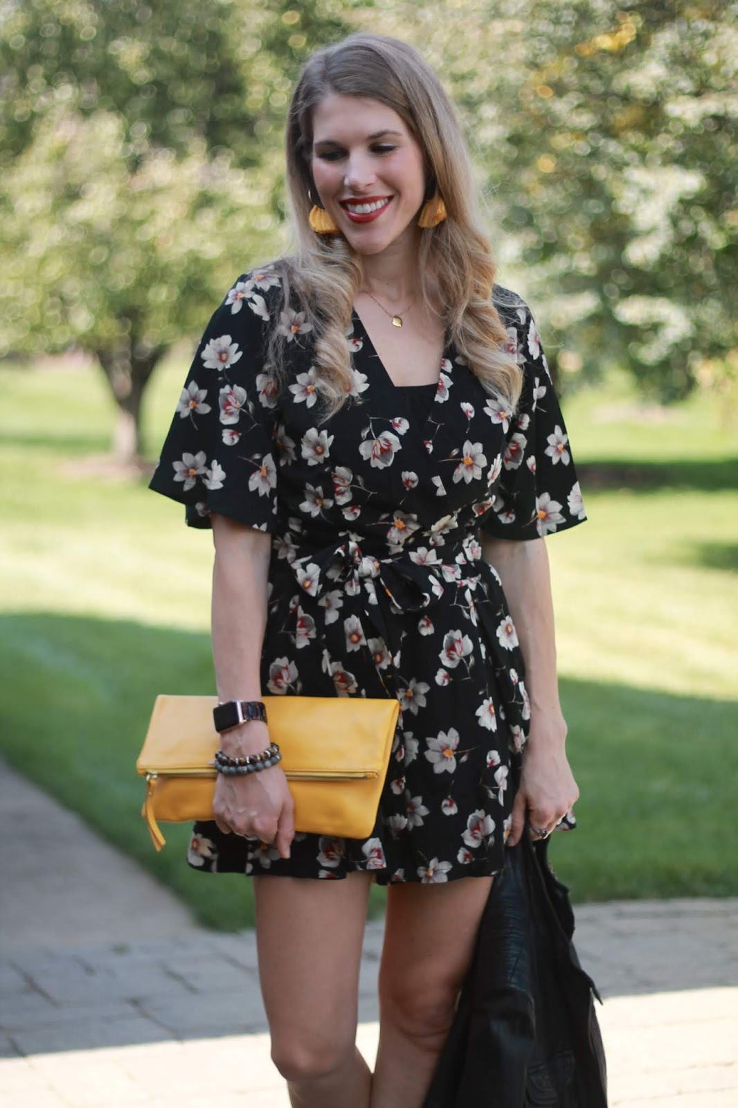 transitioning a romper for fall, black floral romper, black moto jacket, peep toe booties, yellow clutch