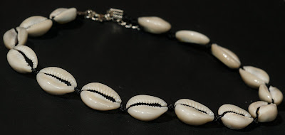 white seashell necklace on black background