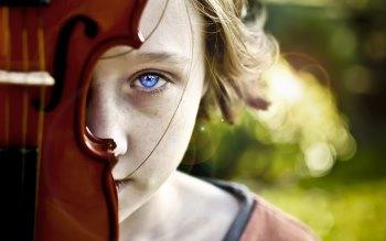 Wallpaper: Behind Blue Eyes Portrait