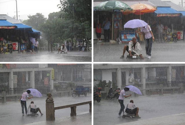 Woman covering a soaked man with her umbrella.