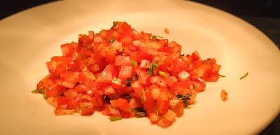 Chopped onion and tomato for scotch eggs recipe