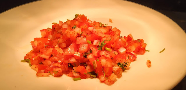 Chopped onion and tomato food recipe