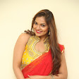 Aswini new sizzling pics in Red half saree-thumbnail