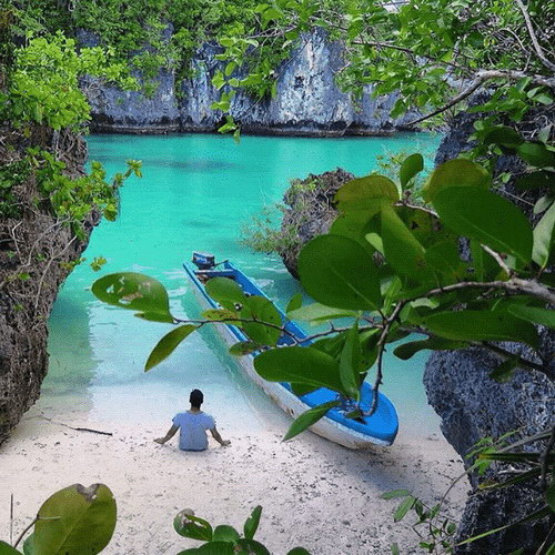 Tinuku Travel Bair Island in Maluku the perfect paradise between high cliffs, clear water turquoise colors and white sandy