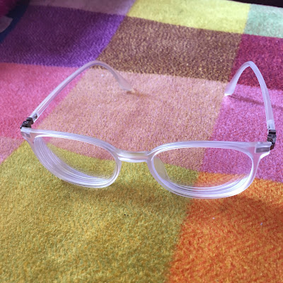 Clear glasses from Glasses Shop dot com with arms unfolded