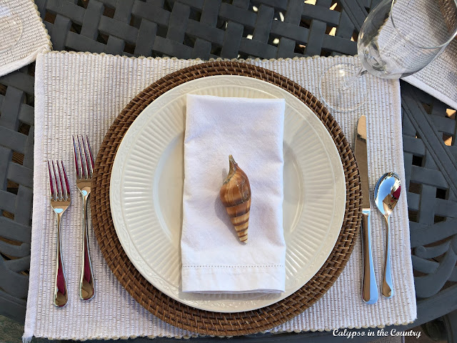 Coastal Table Setting with white napkins