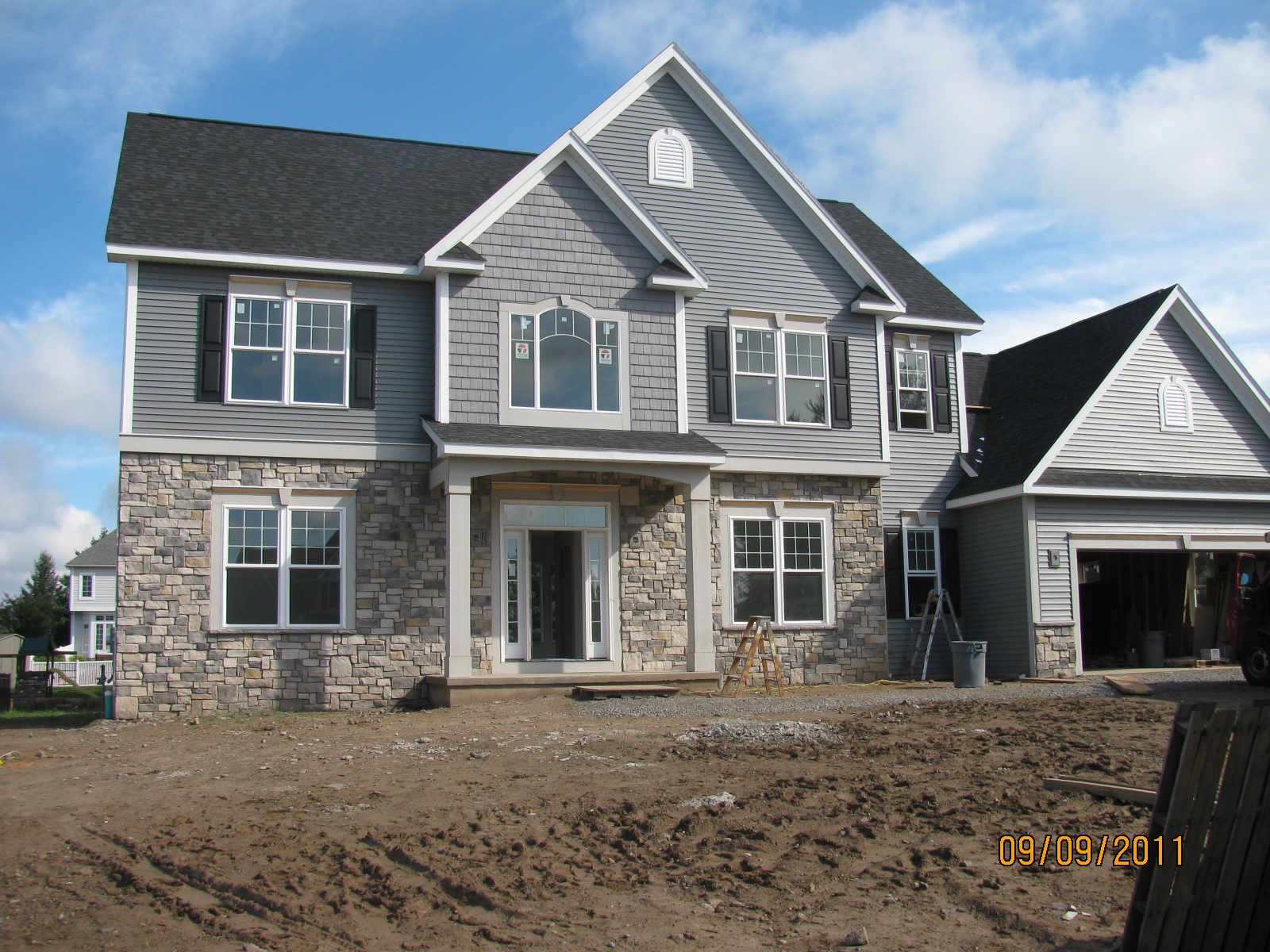 Stone Exterior: Nit's News: Siding, Stone And Primed