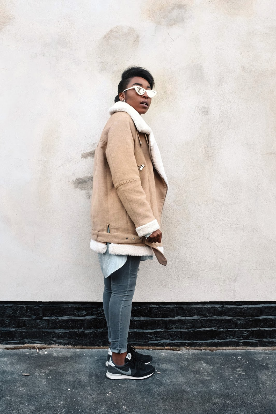 zara sherling coat acne studios velocite alternative adam selman la lolita le specs sunglasses nike internationalist trainers