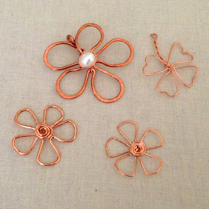 Assorted copper wire flower designs by Lisa Yang Jewelry - free tutorials at her blog