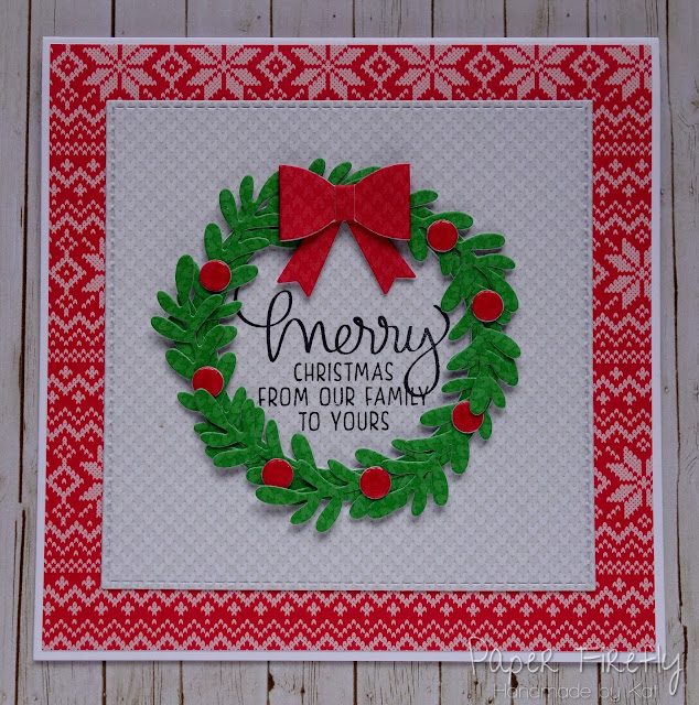 Christmas card with layered wreath around text stamp, using Large Wreath and Knit Picky papers by Lawn Fawn