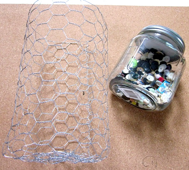 A roll of chicken wire and jar of buttons