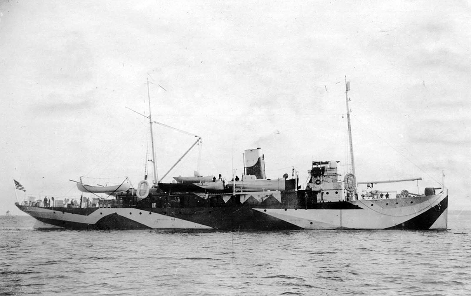 The USS Fulton (AS-1), an American submarine tender painted in Dazzle camouflage, in the Charleston South Carolina Navy Yard on November 1, 1918.