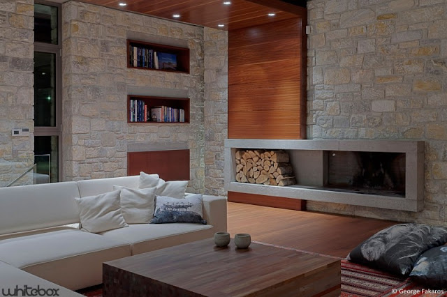fireplace indoor living Stone House in Anavissos