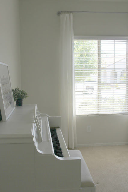 Serene white piano in tranquil room by Hello Lovely Studio