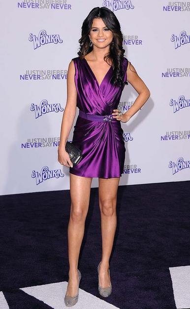 2d45d7359f6fb Selena Gomez looks all grown-up in a purple jewel toned mini.
