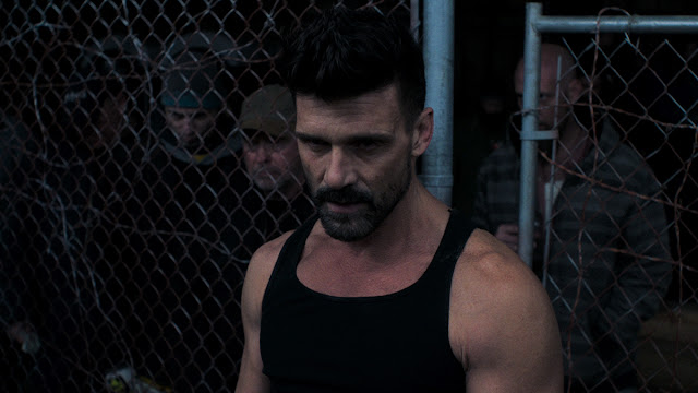 Frank Grillo man in a cage