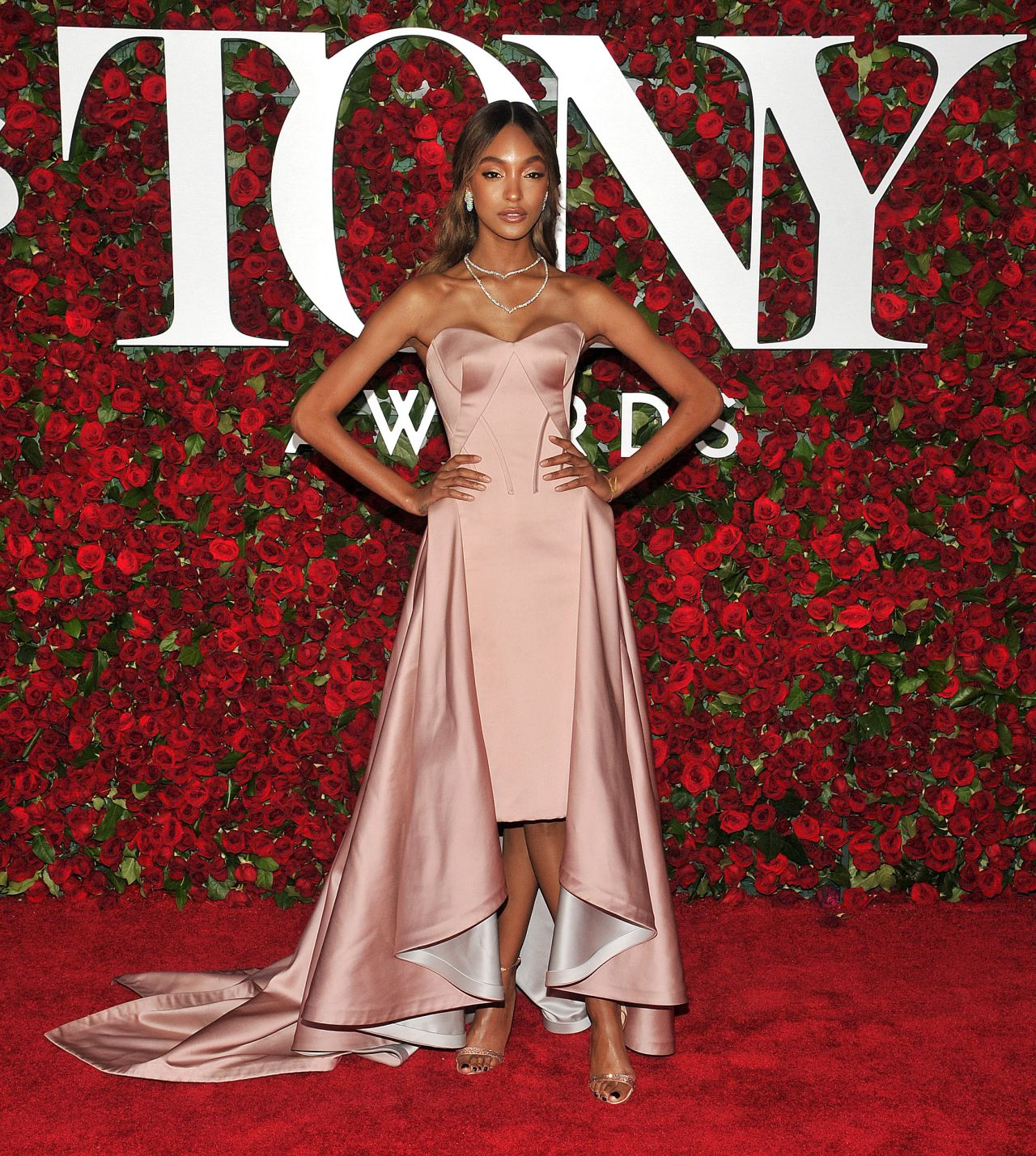 Jourdan Dunn bares cleavage in a strapless gown at the 2016 Tony Awards in NY