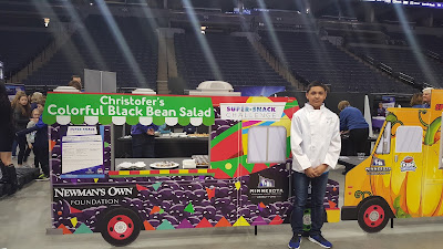 Cristofer Ramirez at super snack challenge in front of food truck