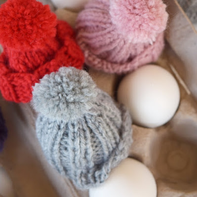 https://www.etsy.com/listing/256525336/egg-cozy-knit-egg-hat-with-pom-pom-color?ref=shop_home_active_11
