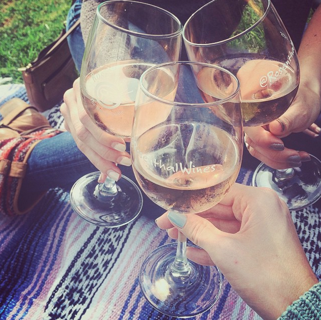 Three girls with wine glasses at Rosenthal Wines