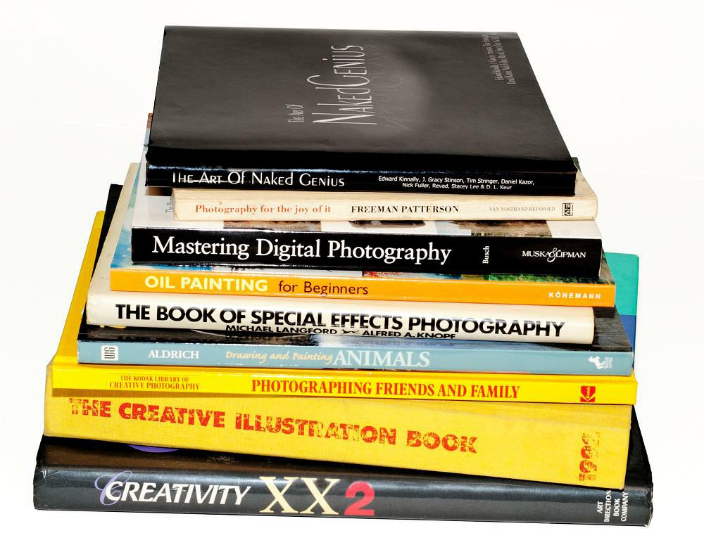 A stack of books related to illustration, art, and photography.