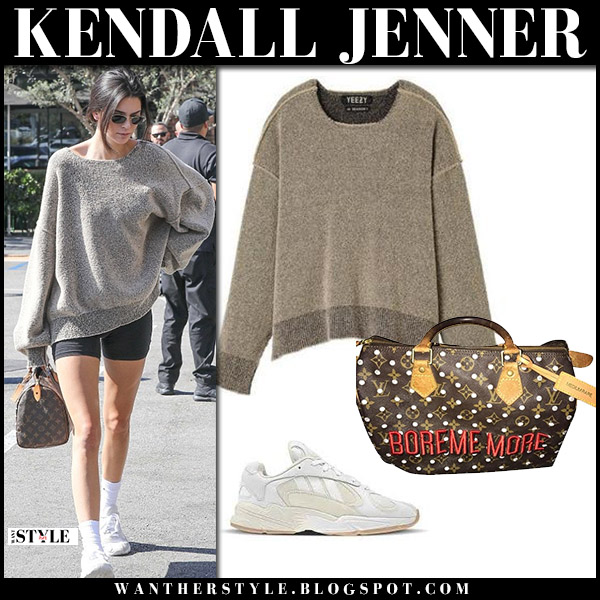 Kendall Jenner in grey oversized yeezy sweater and black bike shorts street fashion july 20