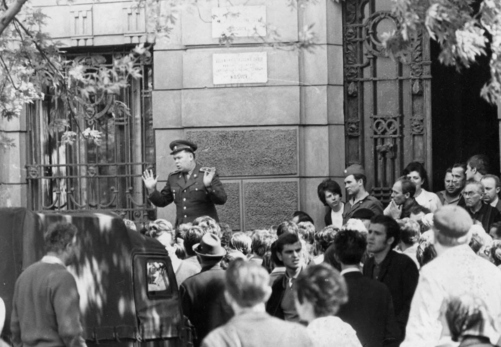 A member of the Czechoslovakian army is jeered by locals in Košice, Czechoslovakia, on August 21, 1968, as he addresses them outside the city hall shortly after troops had occupied the town as part of the Soviet invasion.