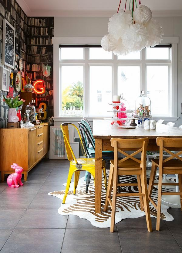 mismatched chairs in colorful dining room