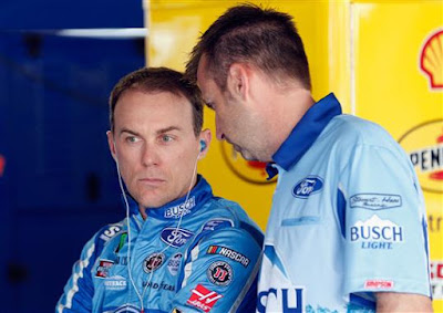 Kevin Harvick and crew chief Rodney Childers talk in the garage after final practice for the Monster Energy NASCAR Cup Series KC Masterpiece 400.