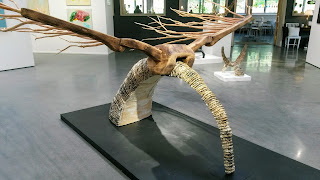 A statue with wooden wings, photographed from another direction.