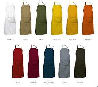 Imagen con los 11 colores disponibles para el delantal largo multiusos OVEN: Blanco, Tierra, Caqui, Amarillo, Mostaza, Naranja, Rojo, Granate, Azul marino, Gris, Negro