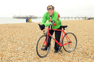 a picture of Roberto from Heart FM at the finish of the London to Brighton