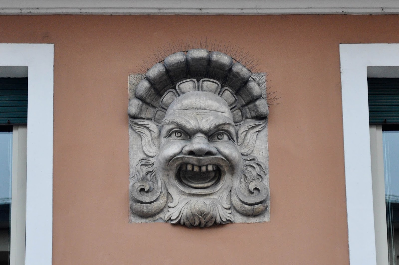 An angry face on the facade of a building in Vicenza, Veneto, Italy
