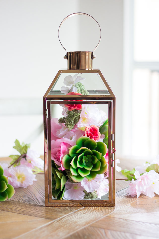 These faux floral lanterns would be perfect for a spring wedding or shower centerpiece!