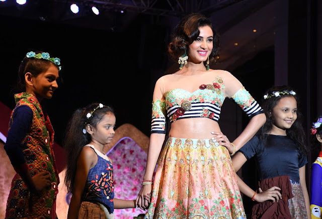 Actress Sonal Chauhan walking the ramp wearing beautiful earrings by Narayan Jewellers at Smile Foundation's Ramp for champs
