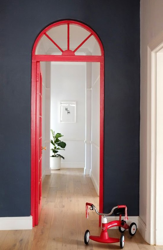 Safari Fusion blog | Colour crush: Red | A red door pops against dark walls, Cape Town, South Africa
