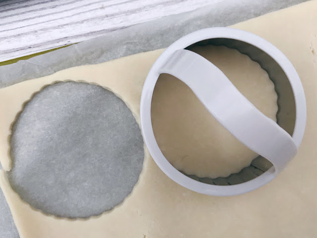 pastry being cut with the cutter