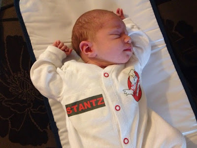 Tin Box Baby 2 in a Ghostbusters baby grow