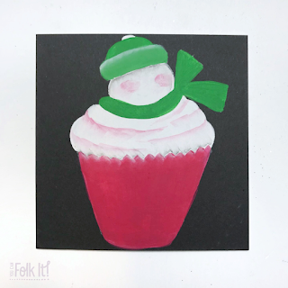 Hand painted snowman topped cupcake with highlighted and shaded areas to make it look 3D
