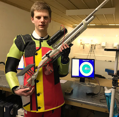 Picture of me in new shooting suit with rifle