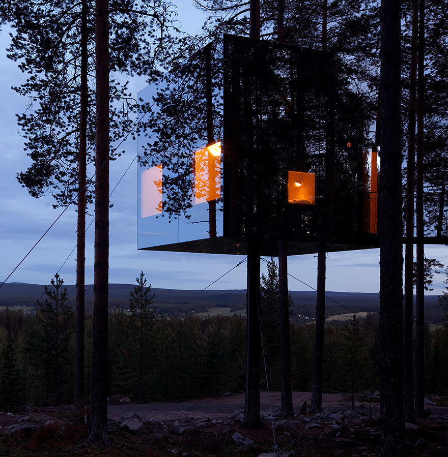 14 Crazy Hotels That Will Give You Serious Travel Goals - The Mirrorcube Tree House Hotel in Sweden is like a hideout in the trees: The entire thing is camouflaged behind mirrored walls.