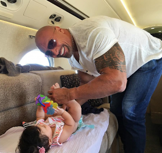 , Aww! The Rock Shares Cute Photo of himself Changing his Daughter's Diapers, Latest Nigeria News, Daily Devotionals & Celebrity Gossips - Chidispalace