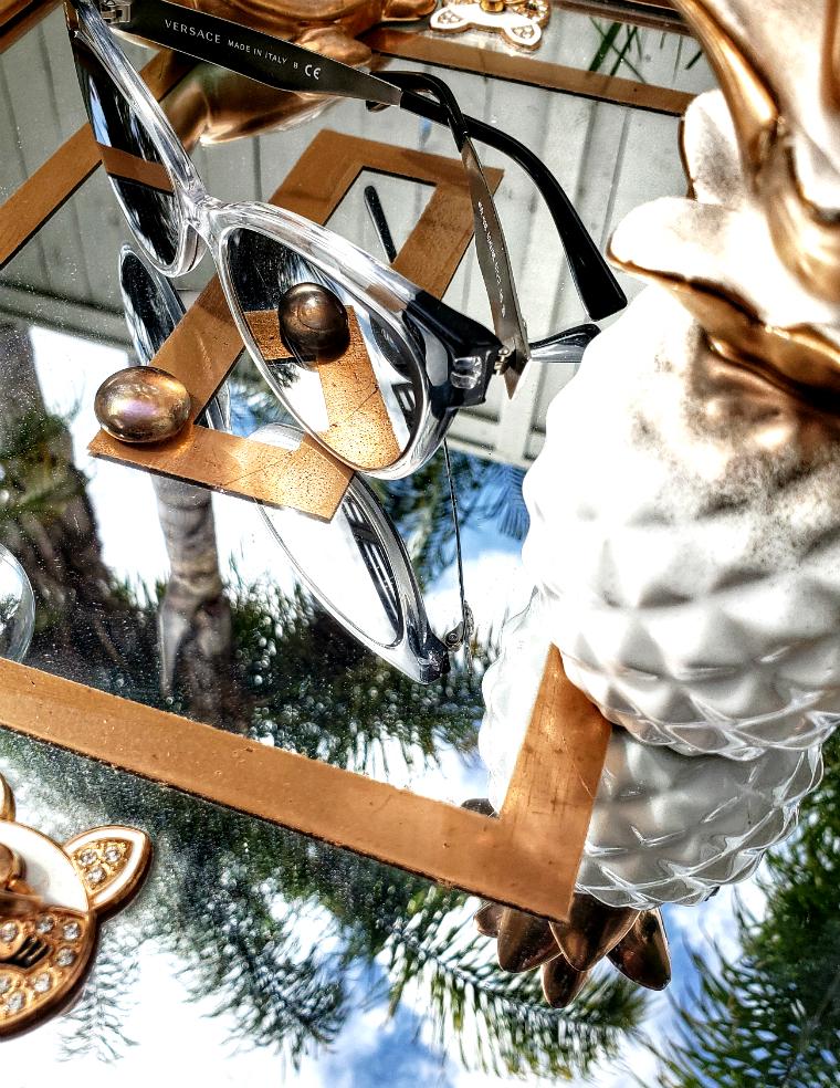 https://www.smartbuyglasses.com/designer-sunglasses/Versace/Versace-VE4338-52436G-363378.html