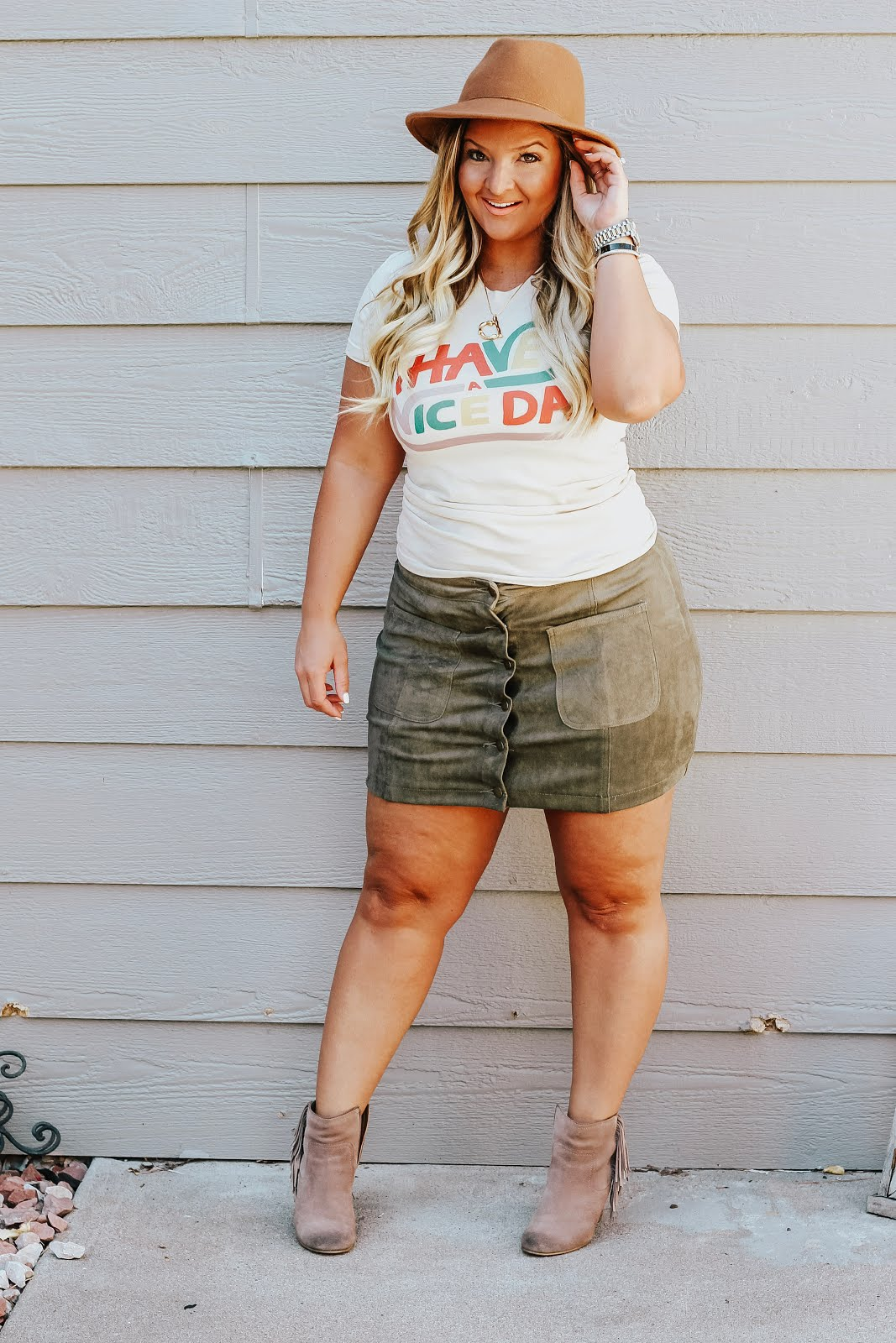 Have a Nice Day T Shirt featured by top Denver fashion blog, Dealyan Denaye: blonde woman wearing a Free People hat, Amazon initial necklace,  Olive & Pepper Have a Nice Day T Shirt, suede skirt, Sam Edelman booties, Michael Kors watch
