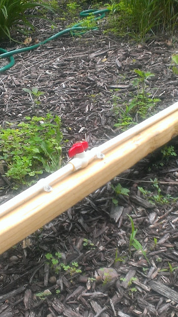 A $5 simple plastic mixing valve is all we needed for our outdoor shower.
