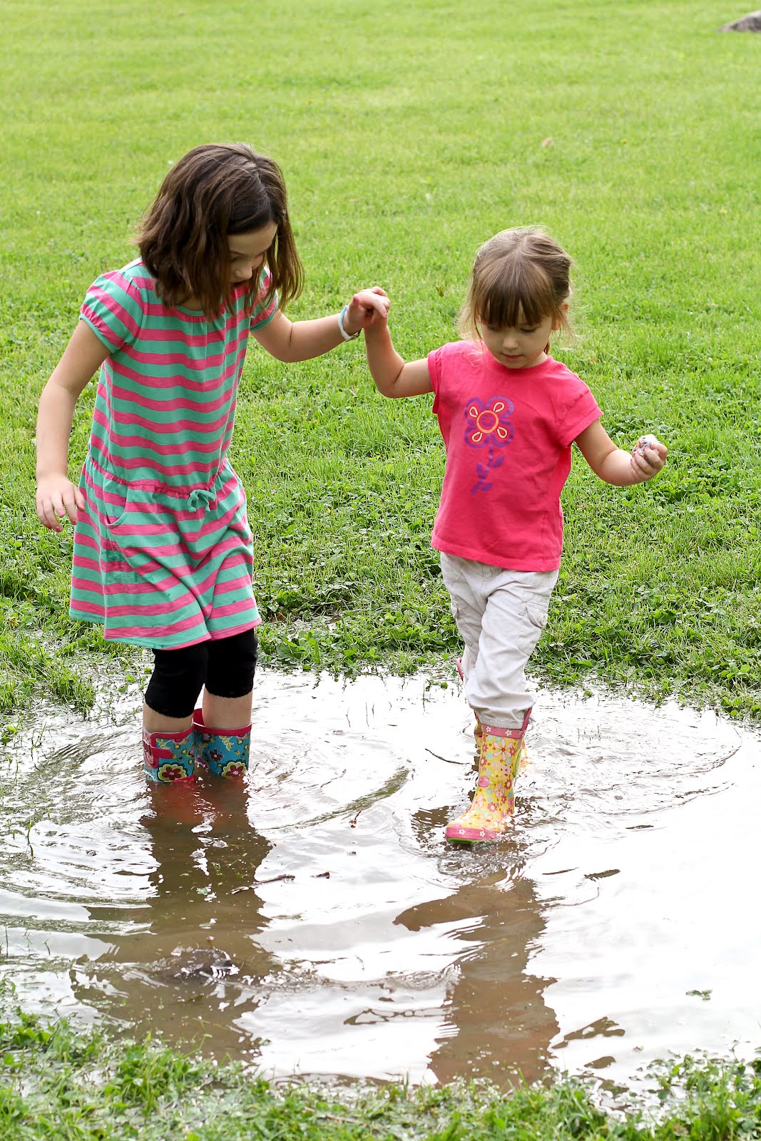 Our new adventures: Puddle jumping in our front yard