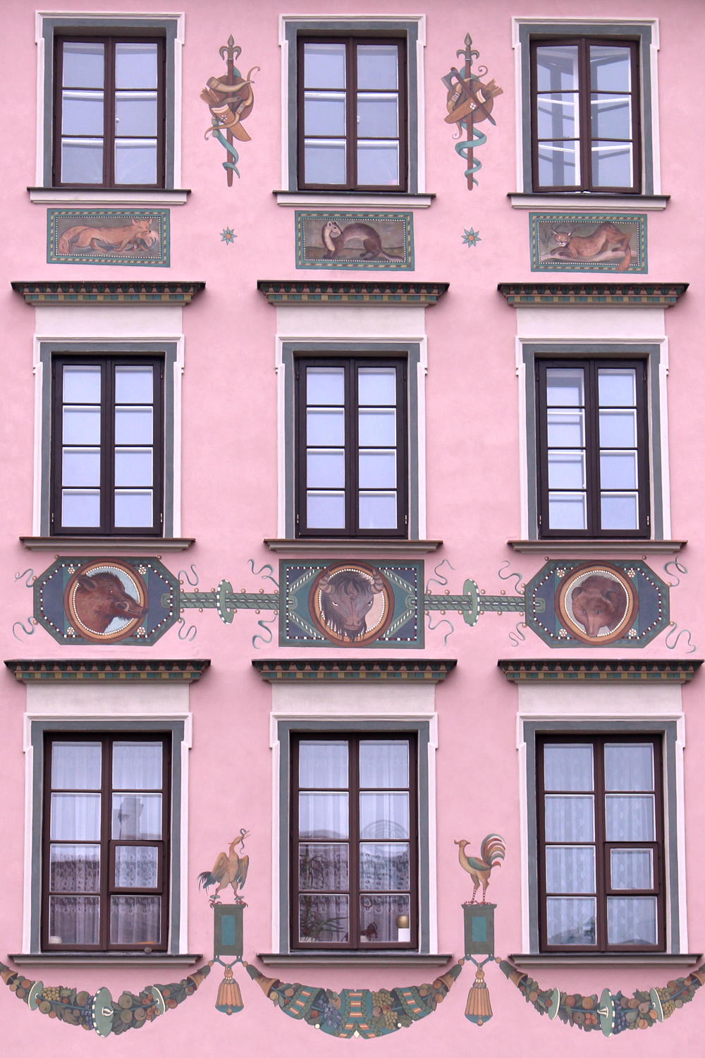 Pretty old pink buildings in Warsaw, Poland - luxury travel blog