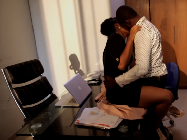 Couple being intimate in the office