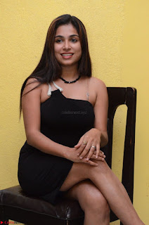 Vrushali Gosavi in strapless Short Black Dress At Follow Follow U Audio Launch 022.JPG