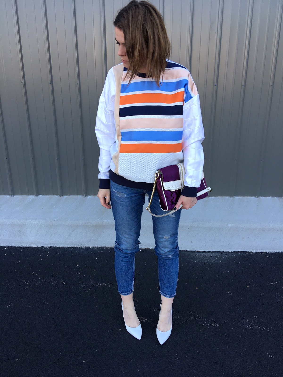 A white blouse with blue and orange stripes!